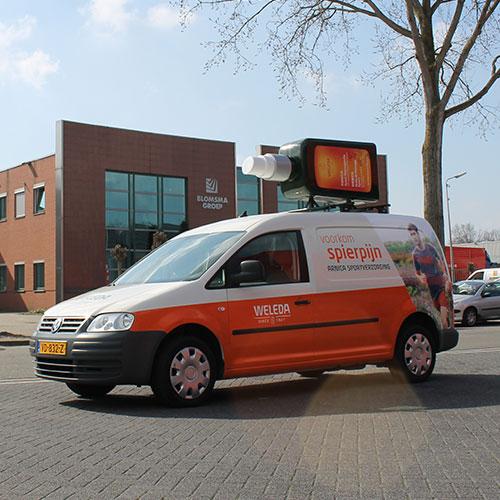 Blomsma Print & Sign autobestickering en blow up promotie Weleda Arnica Sportverzorging